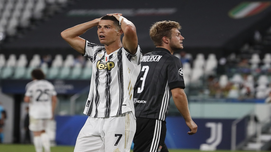 Juventus' Cristiano Ronaldo reacts during the Champions League round of 16 second leg, football match against Lyon at the Allianz stadium in Turin, Italy, Friday, Aug. 7, 2020. (AP Photo/Antonio Calanni).
