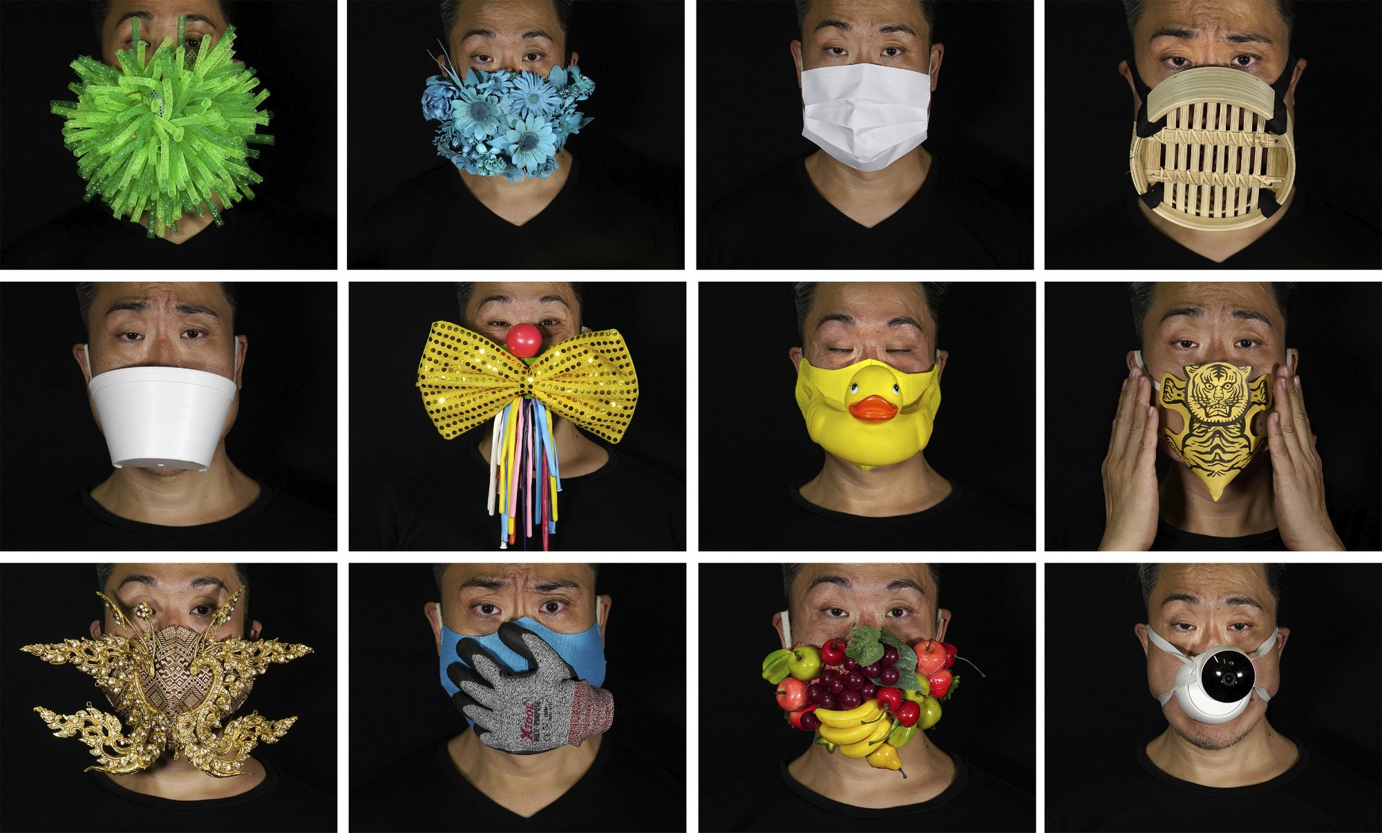 Edmond Kok's creations: a number of eye-catching masks with a hidden meaning. (AP Photo/Vincent Yu)