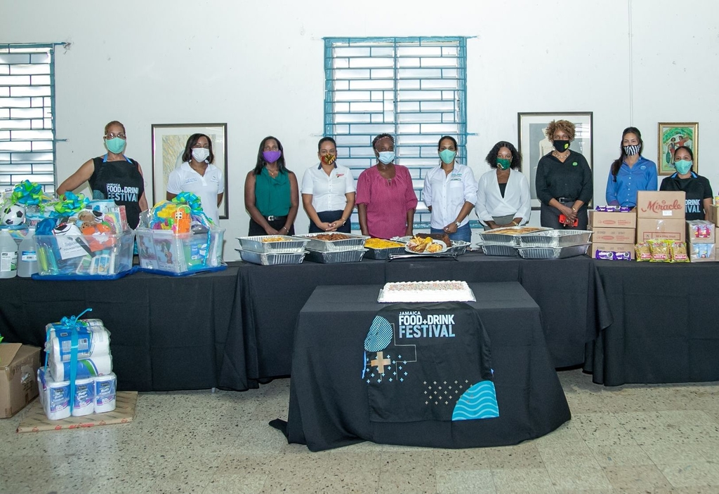 Chefs and sponsors of the JFD Cares initiative at the Maxfield Park Children's Home (MPCH) pose with the Administrator and the amazing spread prepared by the JFDF Chefs.