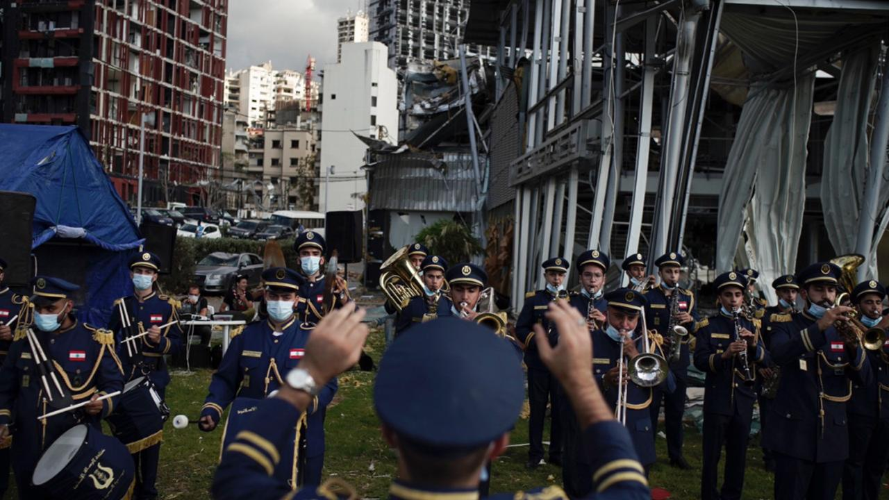 A scouts band performs in honor of the victims of the last week's explosion that killed over 150 people and devastated the city, near the blast site in Beirut, Lebanon, Tuesday, Aug. 11, 2020. (AP Photo/Felipe Dana)