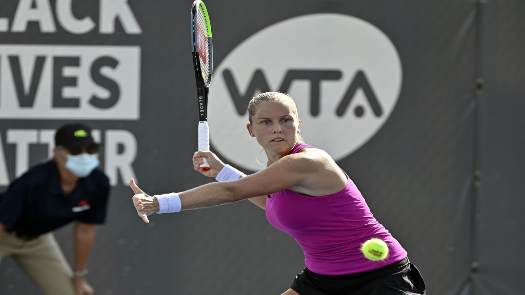 Shelby Rogers returns a shot during action in her WTA tennis tournament match against Serena Williams in Nicholasville, Ky., Friday, Aug. 14, 2020. (AP Photo/Timothy D. Easley).
