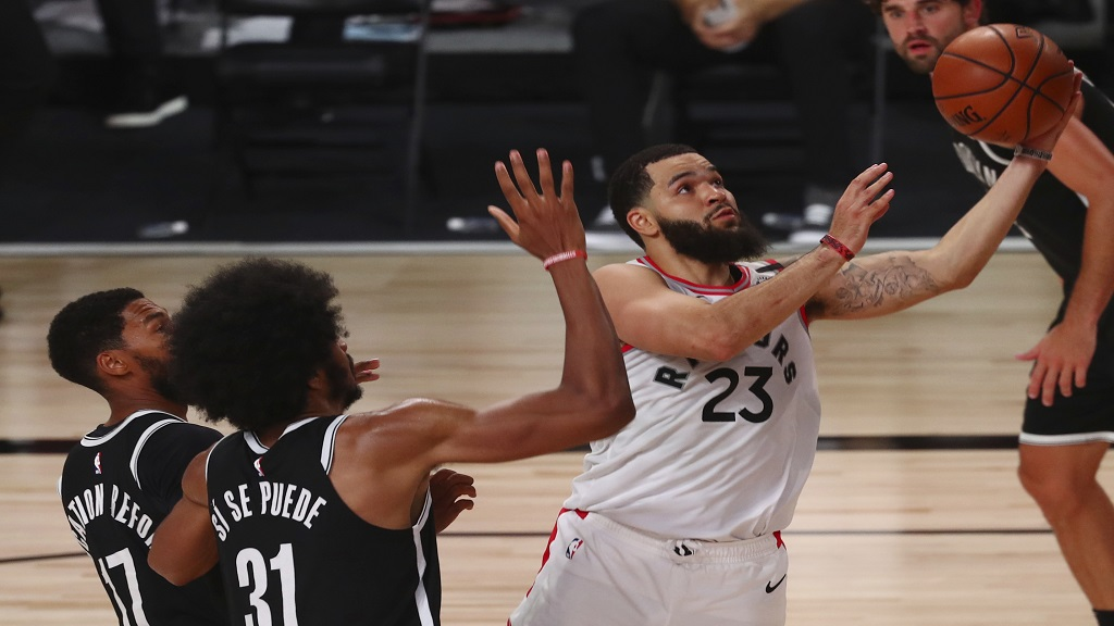 Toronto Raptors guard Fred VanVleet (23) goes up to shoot past Brooklyn Nets center Jarrett Allen (31) and guard Garrett Temple (17) during the second half of Game 1 of an NBA basketball first-round playoff series, Monday, Aug. 17, 2020, in Lake Buena Vista, Fla. (Kim Klement/Pool Photo via AP).