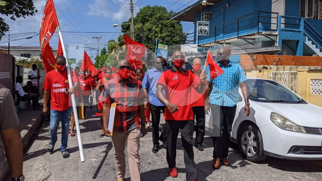 Photo: In this photo dated July 17, 2020, Dr Rowley walks with supporters to file his nomination papers in Carenage for the August 10 general election.