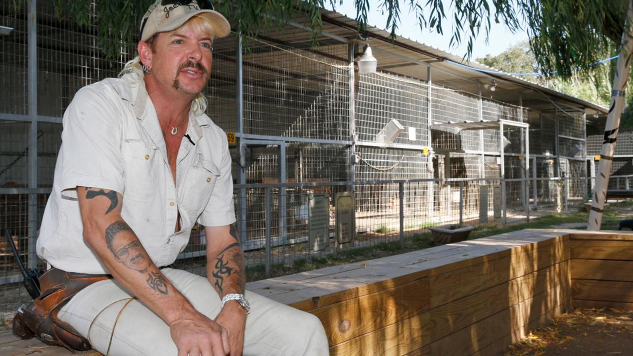 In this Aug. 28, 2013, file photo, the late Joseph Maldonado-Passage, also known as Joe Exotic, answers a question during an interview at the zoo he runs in Wynnewood, Okla. .(AP Photo/Sue Ogrocki, File)