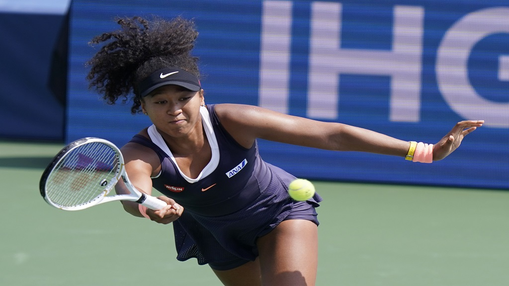Naomi Osaka, of Japan, returns a shot from Elise Mertens, of Belgium, during the semifinals at the Western & Southern Open tennis tournament Friday, Aug. 28, 2020, in New York. (AP Photo/Frank Franklin II).