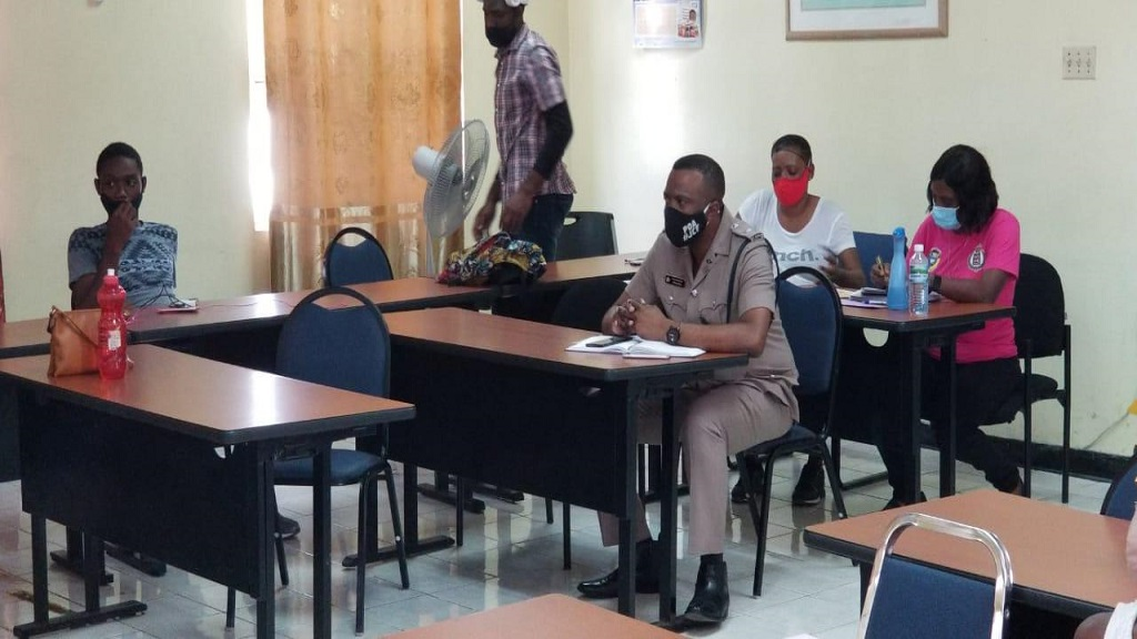 Divisional commander, Superintendent Vernon Ellis (centre, foreground), participating in the presentation ceremony for the St James Police Division's Virtual Youth Literacy Summer Camp 2020 recently.