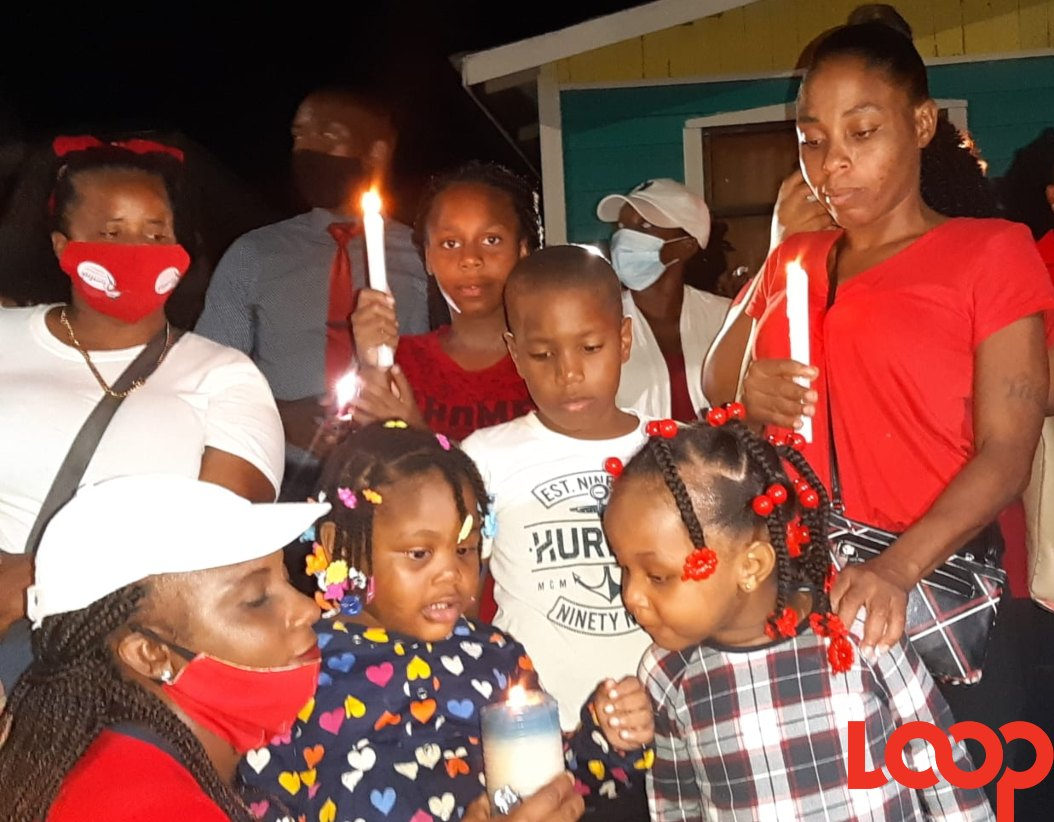 (FILE) Mother Tricia Gibbs, along with Demarco's siblings at a recent candle light vigil.