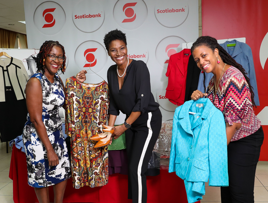 Audrey Tugwell Henry, Executive Vice President, Retail & Small Business Banking at Scotiabank Jamaica is flanked by Minette Bryan ( left) ,chair of the board and Charmaine Lewis (right) , founder of Dress for Success Jamaica, as she symbolically presented more than 100 pieces of corporate wear donated by Scotiabank employees to the charity.