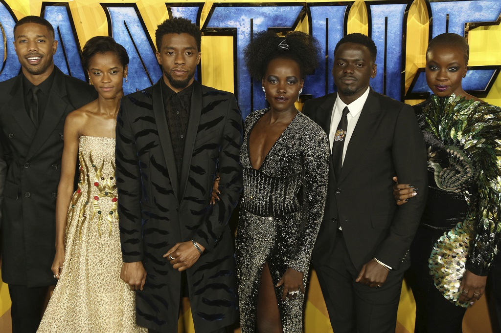 "FILE - In this Feb. 8, 2018 file photo, actors Michael B. Jordan, Leitia Wright, Chadwick Boseman, Lupita Nyong'o, Daniel Kaluuya and Danai Gurira pose for photographers upon arrival at the premiere of the film ""Black Panther"" in London. Boseman, who played Black icons Jackie Robinson and James Brown before finding fame as the regal Black Panther in the Marvel cinematic universe, has died of cancer.  (Photo by Joel C Ryan/Invision/AP, File)"