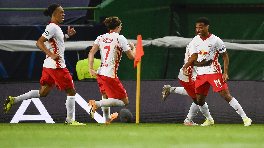Leipzig's Tyler Adams, right, celebrates with teammates after scoring his team's second goal during the Champions League quarterfinal match against Atletico Madrid at the Jose Alvalade stadium in Lisbon, Portugal, Thursday, Aug. 13, 2020. (Lluis Gene/Pool Photo via AP).