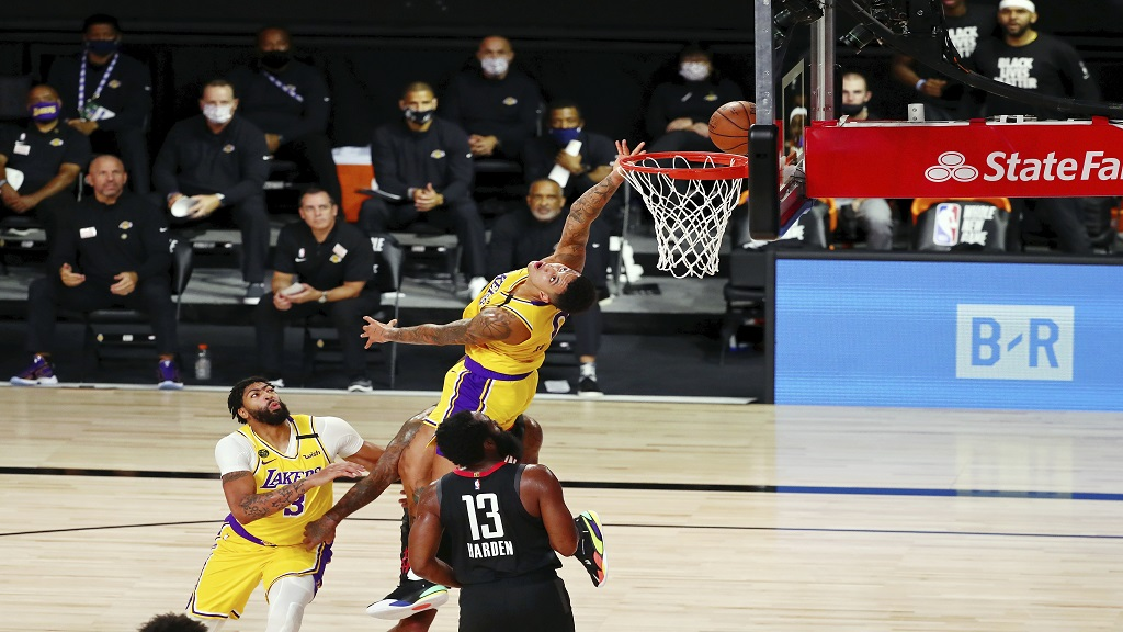 Los Angeles Lakers forward Kyle Kuzma (0) takes a backward shot against the Houston Rockets during the first half of an NBA basketball game Thursday, Aug. 6, 2020, in Lake Buena Vista, Fla. (Kim Klement/Pool Photo via AP).