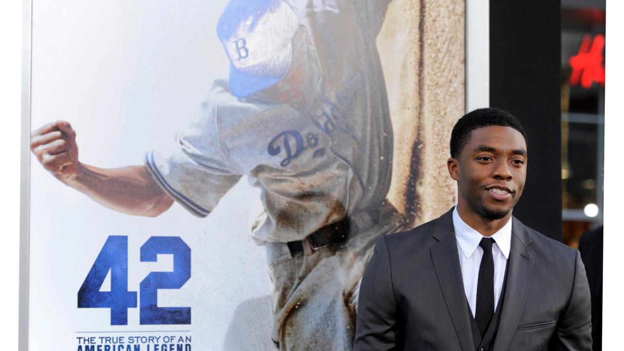 "In this Tuesday, April 9, 2013 file photo, Chadwick Boseman, who plays baseball legend Jackie Robinson in ""42,"" poses at the Los Angeles premiere of the film at the TCL Chinese Theater in Los Angeles. (Photo by Chris Pizzello/Invision/AP, File)"