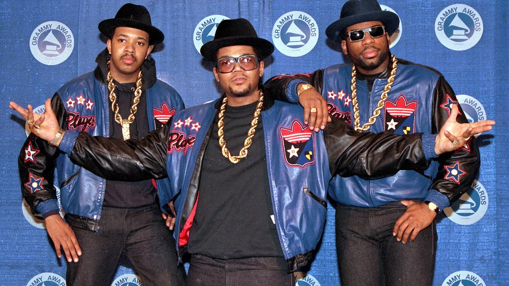 "FILE - The rap group Run-DMC, from left, Joseph ""Run"" Simmons, Darryl ""DMC"" McDaniels, and Jason Mizell ""Jam Master Jay,"" poses at the 31st annual Grammy Awards in New York, on March 2, 1988. (AP Photo/Mark Lennihan, File)"