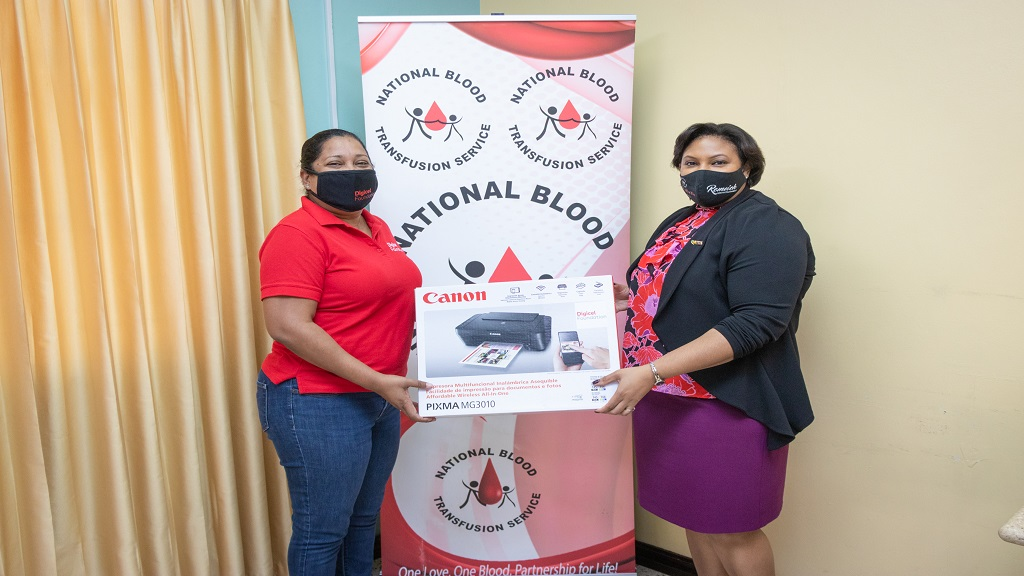 Charmaine Daniels (left), CEO of Digicel Foundation, presenting the desktop computers to Dr Alisha Tucker, Acting Director of the National Blood Transfusion Services.