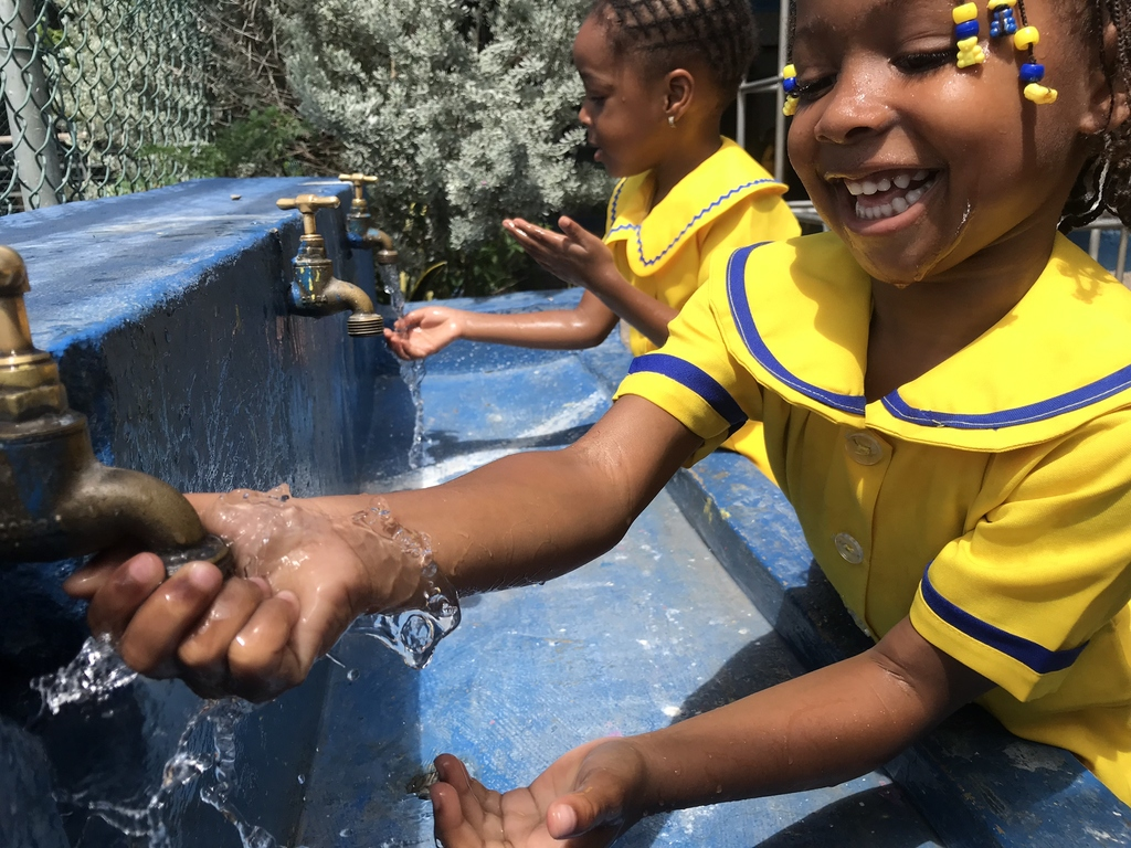 Students at Glendevon Primary and Infant School in St James take a moment to wash their hands.