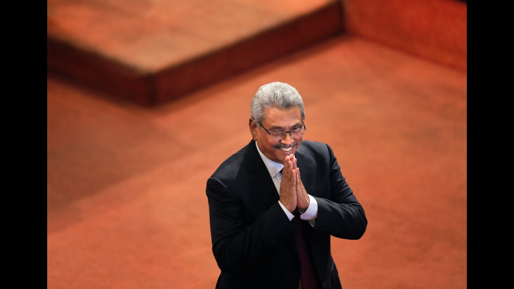 Sri Lankan President Gotabaya Rajapaksa greets ruling party lawmakers as he departs along the well of the parliament after delivering his policy speech in Colombo, Sri Lanka, Thursday, Aug. 20, 2020. (AP Photo/Eranga Jayawardena)