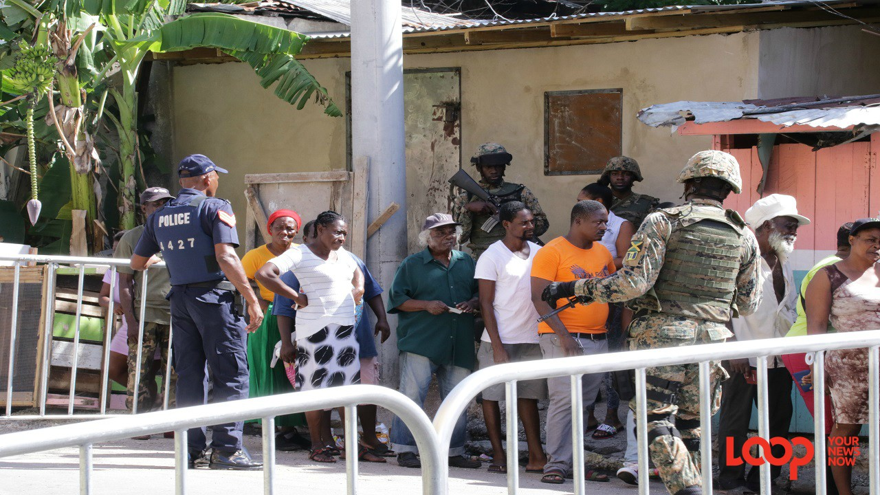 Members of the security force in West Kingston on Tuesday morning.