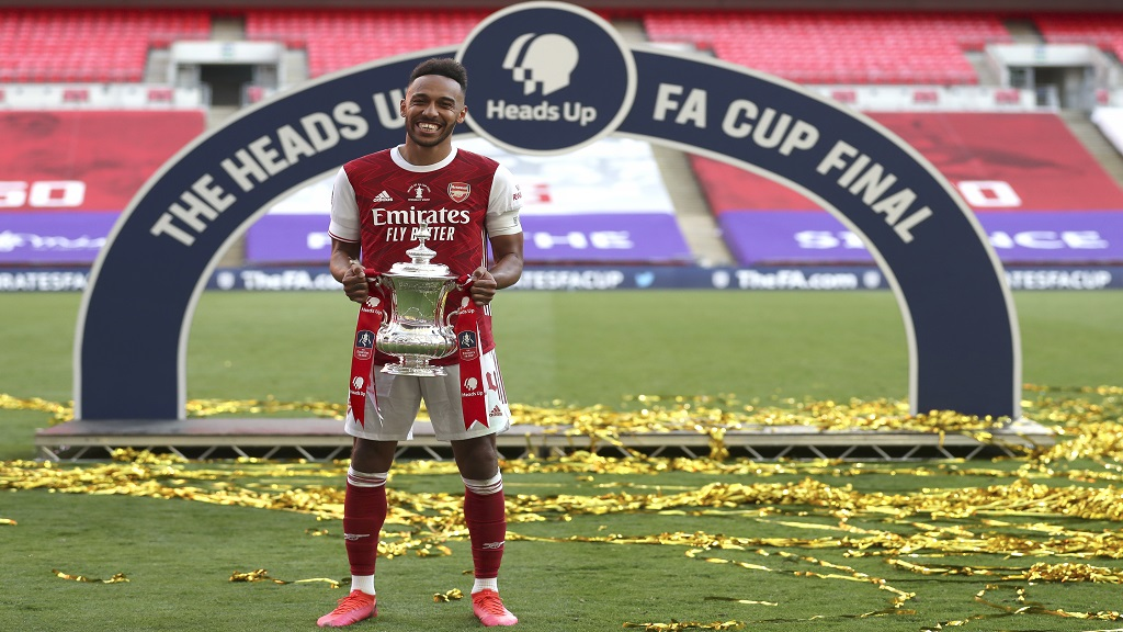 Arsenal's Pierre-Emerick Aubameyang poses with the trophy after the FA Cup final against Chelsea at Wembley stadium in London, England, Saturday, Aug.1, 2020. (Catherine Ivill/Pool via AP).