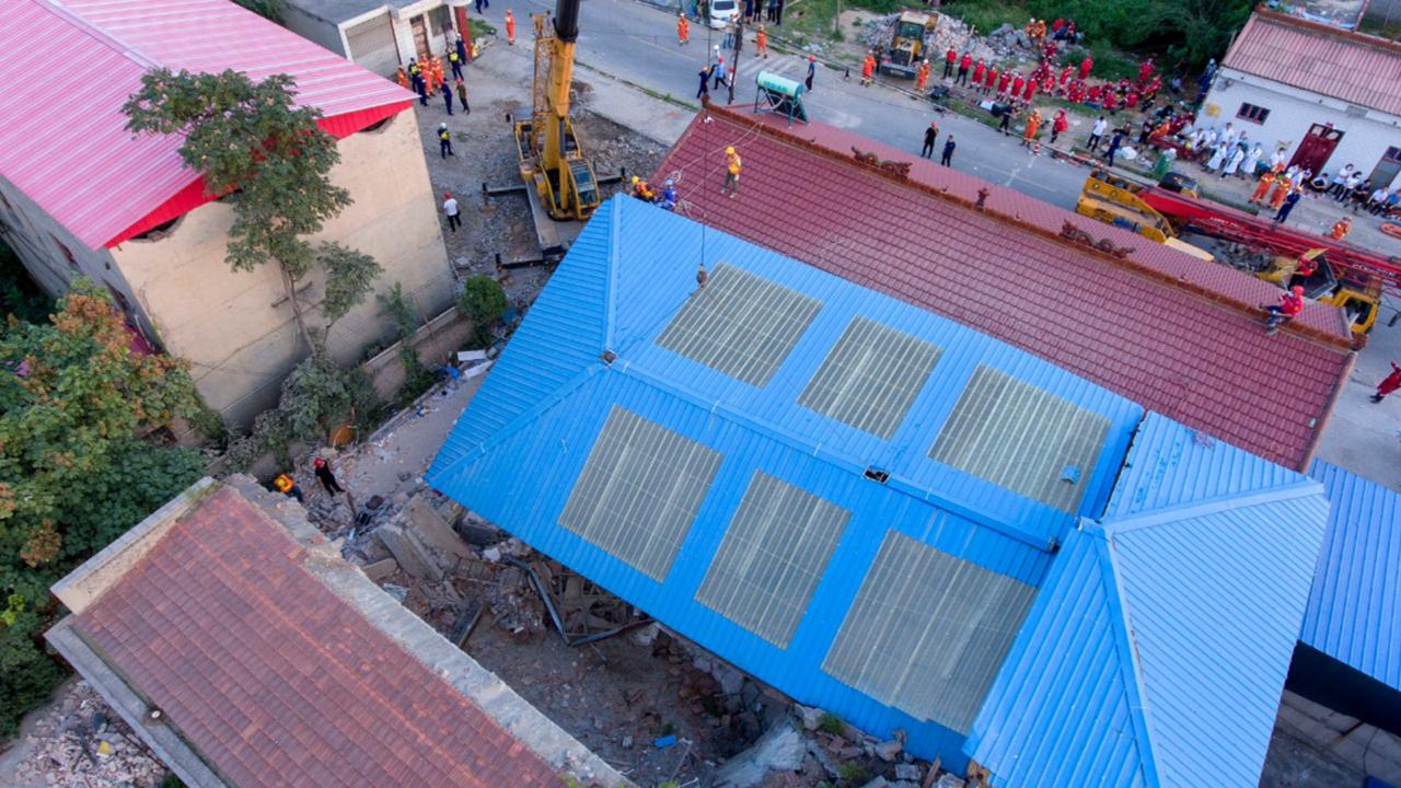 In this aerial photo released by Xinhua News Agency, rescue workers are seen near the site of a collapsed two-story restaurant in Xiangfen County of Linfen City, northern China's Shanxi Province, Saturday, Aug 29.