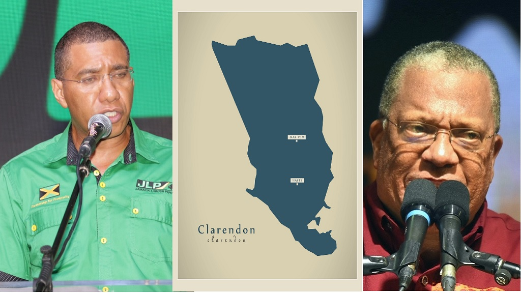 Andrew Holness (left) and Dr Peter Phillips on either side of a map of Clarendon.