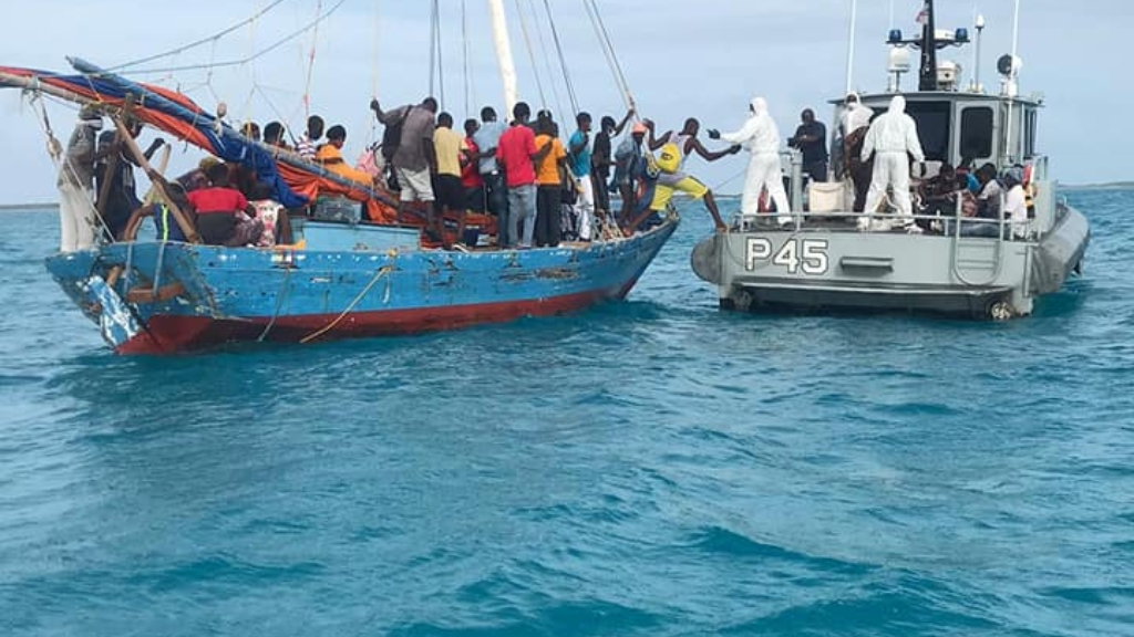 Members of the Royal Bahamas Defence Force removing illegal Haitian migrants from a vessel near the Exuma island chain on August 3, 2020. Photo: Royal Bahamas Defence Force