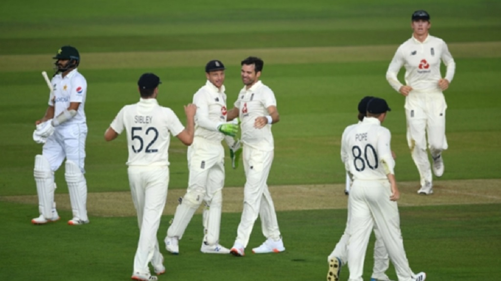 England players celebrate the fall of a wicket.