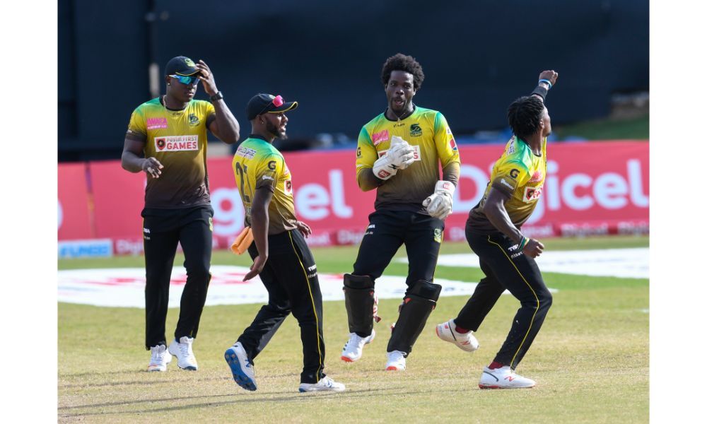 Jamaica Tallawahs fast bowler Fidel Edwards celebrates a wicket against the St Kitts and Nevis Patriots, as (left to right) Rovman Powell, Jermaine Blackwood and Chadwick Walton watch on in Game 18 of the 2020 Hero Caribbean Premier League at the Queen's Park Oval in Port-of-Spain, Trinidad on 29th August 2020. (Photo by Randy Brooks - CPL T20/Getty Images)