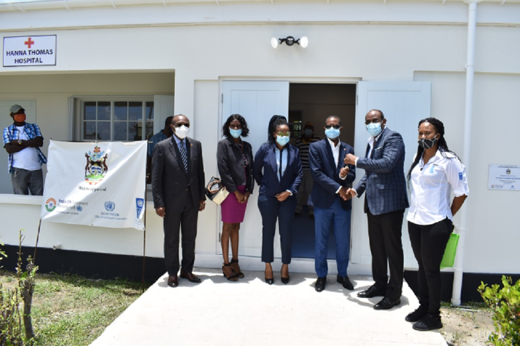 Antigua and Barbuda Prime Minister Gaston Browne (second from right) hands over the key to the newly rehabilitated and equipped Hannah Thomas Hospital to Barbuda MP Trevor Walker, which was funded under the India-UN Development Fund.