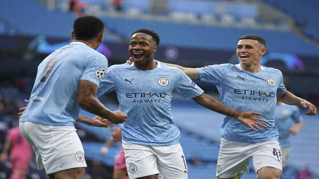 Manchester City's Raheem Sterling, centre, celebrates after scoring the opening goal during the Champions League round of 16, second leg football match against Real Madrid at the Etihad Stadium stadium in Manchester, England, Friday, Aug. 7, 2020. (AP Photo/Dave Thompson, Pool).