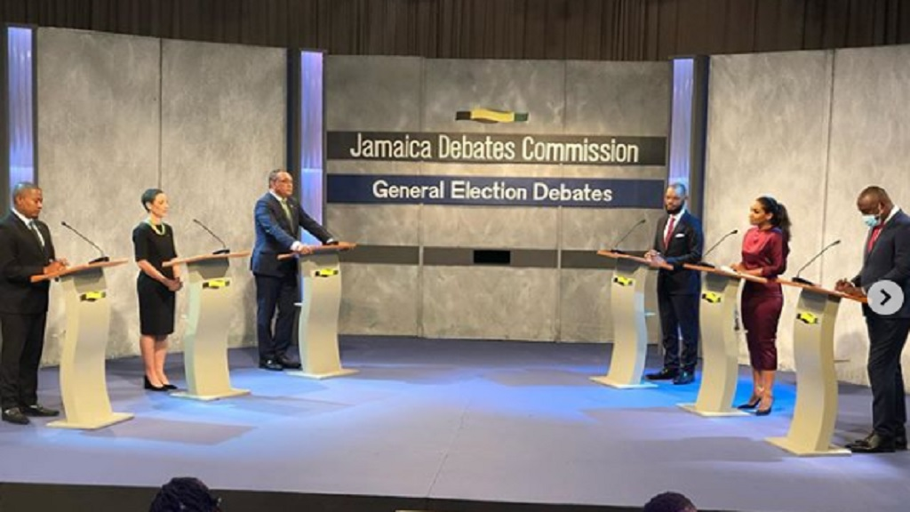 Representatives oftheJamaica Labour Party and the People's National Party on stage for the first of three national political debates at the Creative Production and Training Centre on Tuesday.