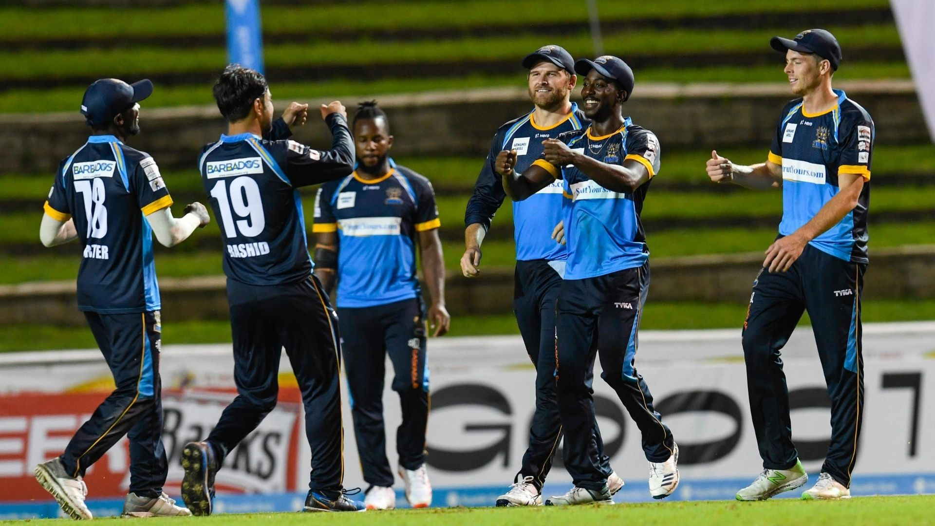 Hayden Walsh Jr. (2R), Corey Anderson (3R) and Mitchell Santner (R) of Barbados Tridents celebrate the dismissal of Denesh Ramdin of St Kitts & Nevis Patriots during the Hero Caribbean Premier League match 2 between Barbados Tridents and St Kitts & Nevis Patriots at Brian Lara Cricket Academy on August 18, 2020 in Tarouba, Trinidad And Tobago. (Photo by Randy Brooks - CPL T20/CPL T20 via Getty Images)