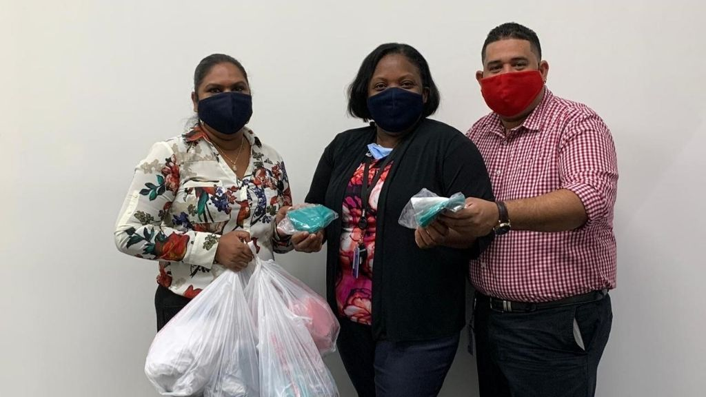 NAU social committee members donating reusable masks for distribution to clients.