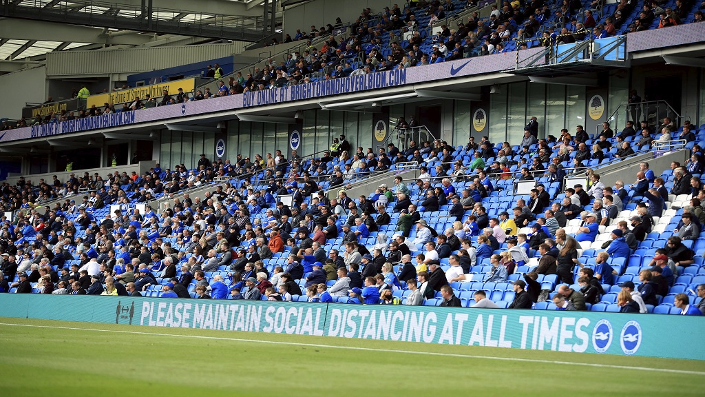 Brighton football fans adhere to social distancing measures in the stands as they watch the action on the pitch during the pre-season friendlyagainst Chelsea, at the AMEX Stadium in Brighton, England, Saturday, Aug. 29, 2020. (Adam Davy/PA via AP).