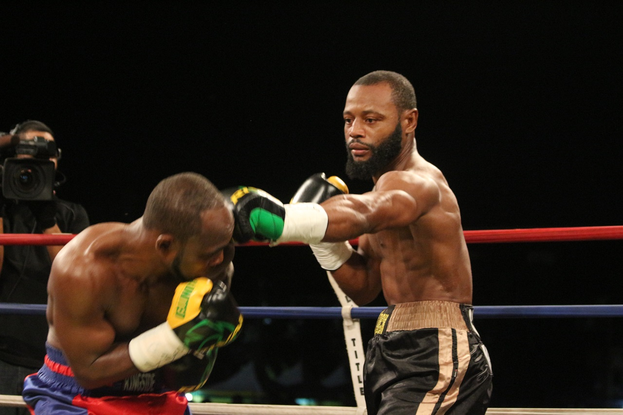 Sakima Mullings (right) and Tsetsi Davis, two of Jamaica's finest professional boxers, in action in a semi-final bout of the 2017 Wray and Nephew Contender boxing series at the Mico University.