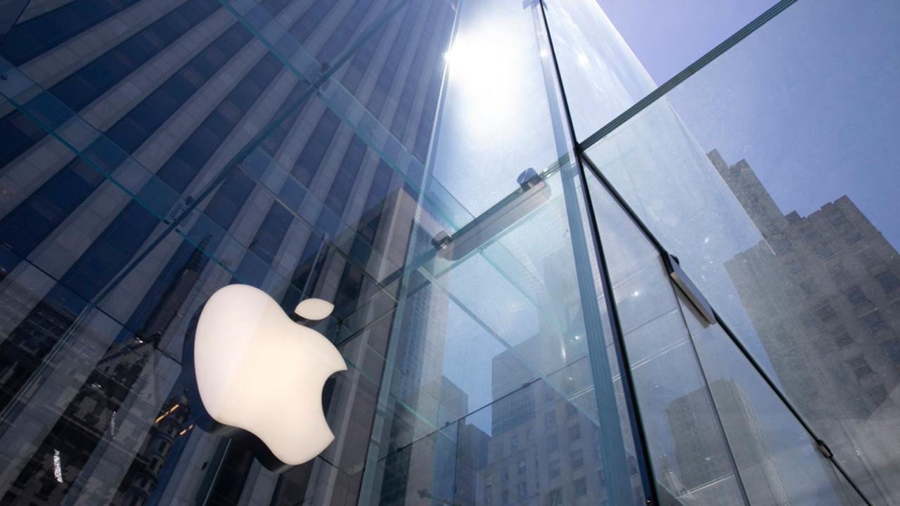 In this June 16, 2020 file photo, the sun is reflected on Apple's Fifth Avenue store in New York. Apple is the first U.S. company to boast a market value of $2 trillion, just two years after it became the first to reach $1 trillion. Apple shares have gained nearly 60% this year as the company overcame the shutdown of factories in China that produce the iPhone and the closure of its retail sales amid the coronavirus pandemic. (AP Photo/Mark Lennihan, File)