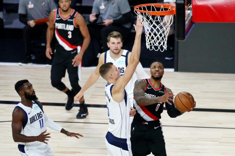 Damian Lillard's third 60-point game of the season has put Portland on the brink of a place in the playoffs