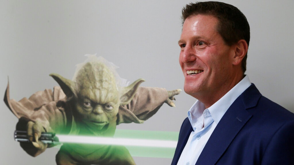 "In this July 13, 2015, file photo, then Disney chief strategy officer Kevin Mayer visits the company's ""accelerator"" space in Glendale, California (AP Photo/Damian Dovarganes, File)"