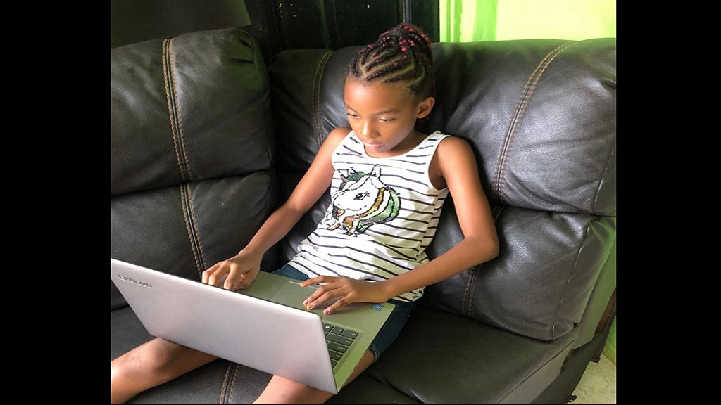 Brianna Mullings, a student at the Hopewell Preparatory School in Santa Cruz, St Elizabeth received the award for the top grade four female student.