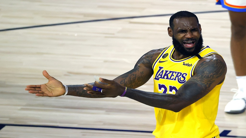 LeBron James of the Los Angeles Lakers reacts to a call against the Oklahoma City Thunder during the second half of an NBA basketball game Wednesday, Aug. 5, 2020, in Lake Buena Vista, Fla. (Kevin C. Cox/Pool Photo via AP).