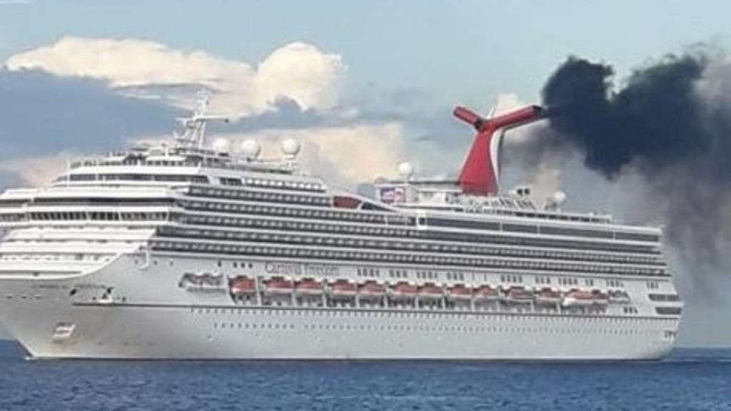 This is an image of a Carnival Cruise reportedly breaching air emissions laws in the Cayman Islands; Image source: Cruise Law News, October 29, 2019