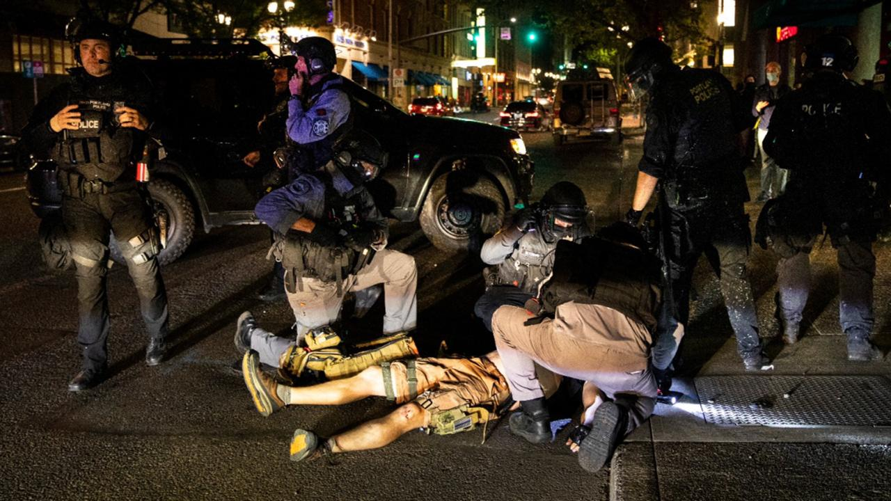 A man is being treated after being shot Saturday, August 29, 2020, in Portland, Oregon. Fights broke out in downtown Portland Saturday night as a large caravan of supporters of President Donald Trump drove through the city, clashing with counter-protesters. (AP Photo/Paula Bronstein)