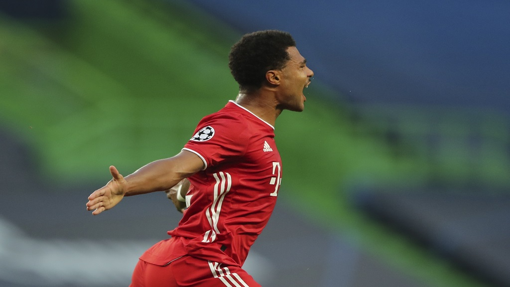 Bayern's Serge Gnabry celebrates after scoring the opening goal for his team during the Champions League semifinal football match against Lyon at the Jose Alvalade stadium in Lisbon, Portugal, Wednesday, Aug. 19, 2020. (Miguel A. Lopes/Pool via AP).