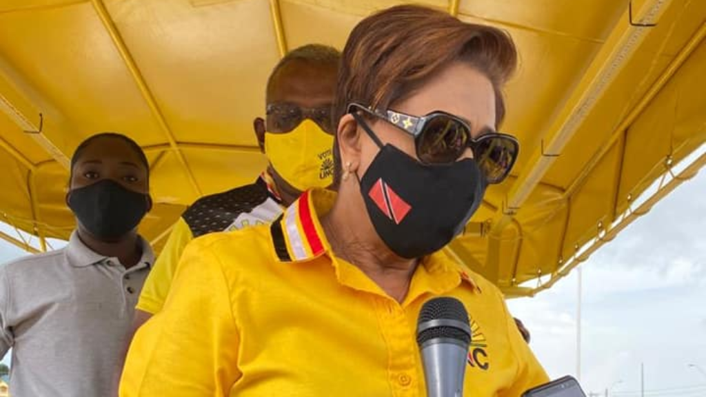 File photo: Opposition Leader Kamla Persad-Bissessar speaks with reporters during a recent motorcade.