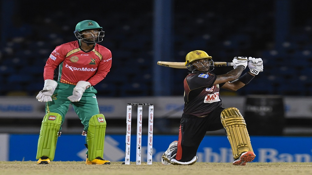 Tion Webster (right) of Trinbago Knight Riders hits a six  as Nicholas Pooran of Guyana Amazon Warriors watches during the 16th match of the Hero Caribbean Premier League at Queen's Park Oval in Port-of-Spain, Trinidad and Tobago on Thursday, August 27, 2020. (Photo by Randy Brooks - CPL T20/CPL T20 via Getty Images).