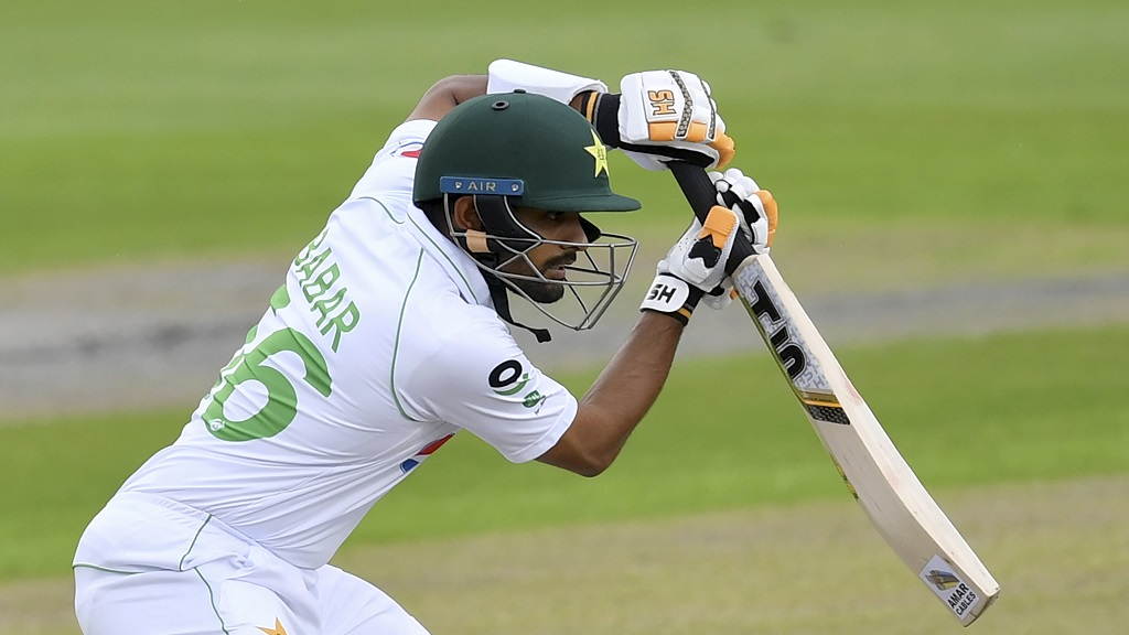Pakistan's Babar Azam bats during the first day of the first cricket Test match against England at Old Trafford in Manchester, England, Wednesday, Aug. 5, 2020. (Dan Mullan/Pool via AP).