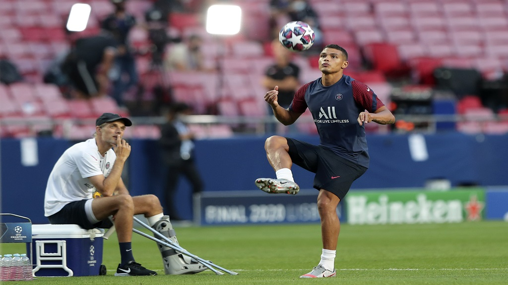 PSG's head coach Thomas Tuchel watches Thiago Silva play with a ball during a training session at the Luz stadium in Lisbon, Saturday Aug. 22, 2020.  (Miguel A. Lopes/Pool via AP).