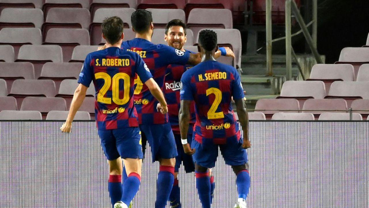 L'attaquant de Barcelone, Lionel Messi (c), fête le 2e but de de son équipe lors du 8e de finale retour de la Ligue des champions face à Naples, au Camp Nou, le 8 août 2020 (LLUIS GENE)