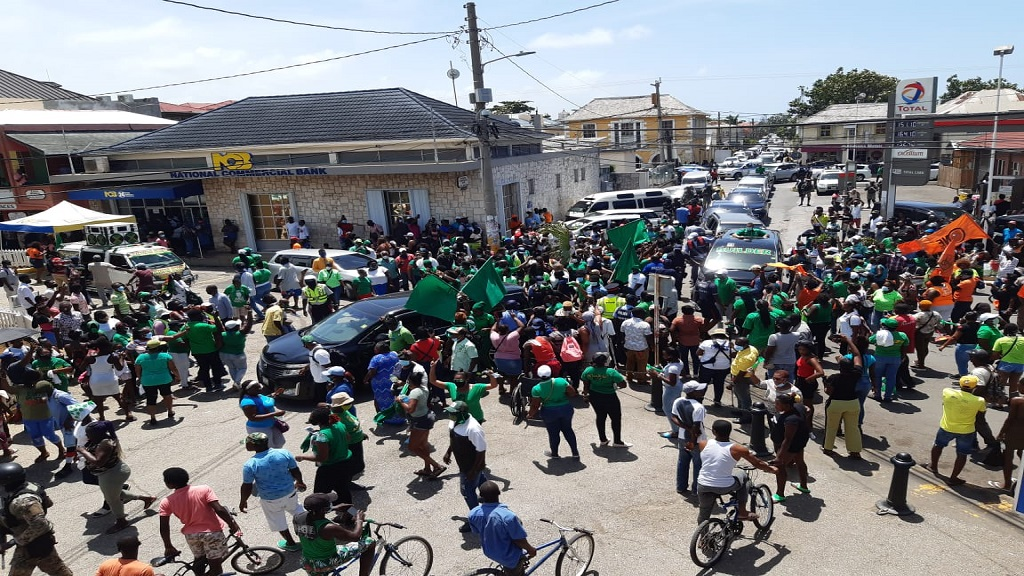 Jamaica Labour Party (JLP) and People's National Party (PNP) supporters in Falmouth, Trelawny on Monday.