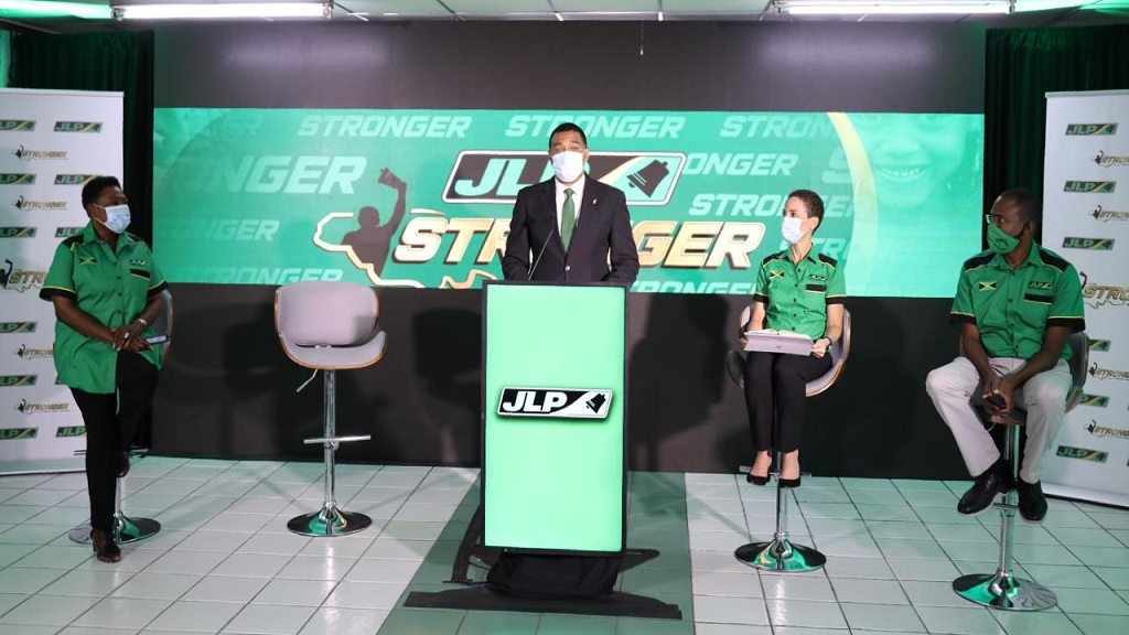 JLP Leader Andrew Holness addressing a virtual press conference. Also pictured are JLP campaign team members Olivia Grange, Kamina Johnson Smith and Dr Nigel Clarke.