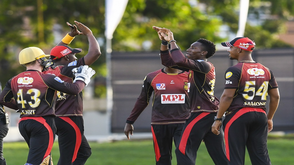Khary Pierre (second right) of Trinbago Knight Riders celebrates with teammates the dismissal of Chanderpaul Hemraj of Guyana Amazon Warriors during Match 16 of the Hero Caribbean Premier League  at Queen's Park Oval in Port-of-Spain, Trinidad and Tobago on Thursday, August 27, 2020. (Photo by Randy Brooks - CPL T20/CPL T20 via Getty Images).